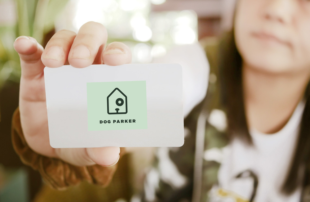 a Dog Parker membership card that gives access to rental dog houses