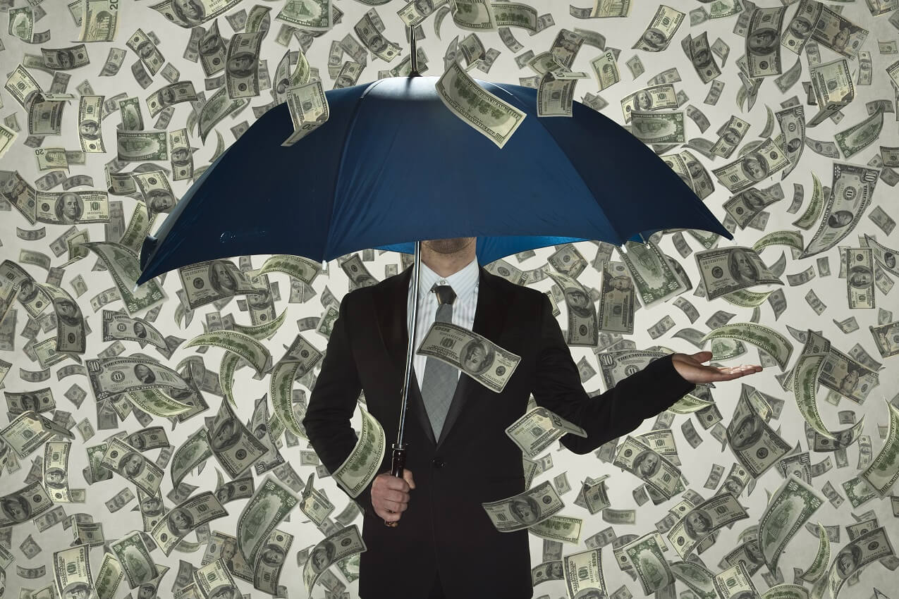 money raining on umbrella representing billion-dollar startups