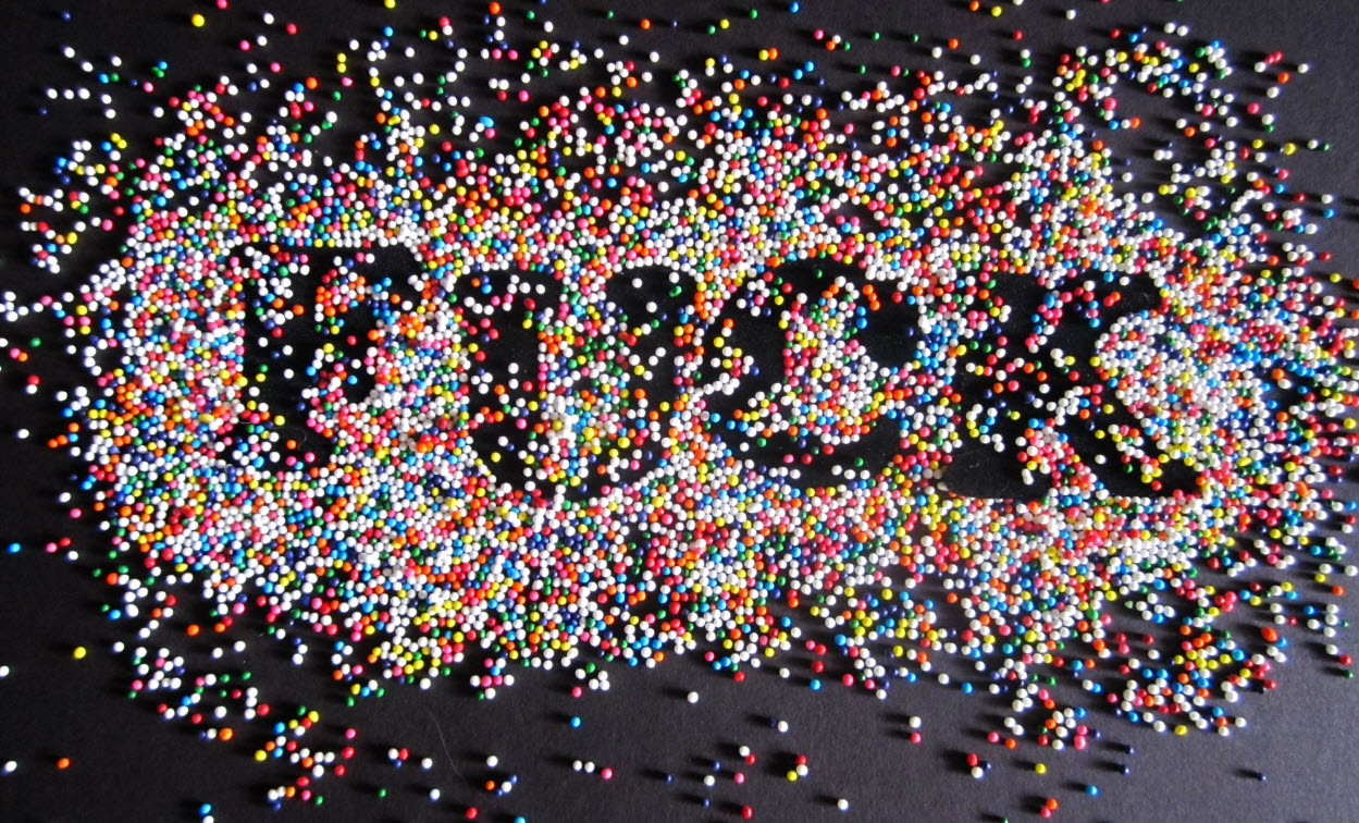 the word fuck spelled out with colorful candy representing startup culture