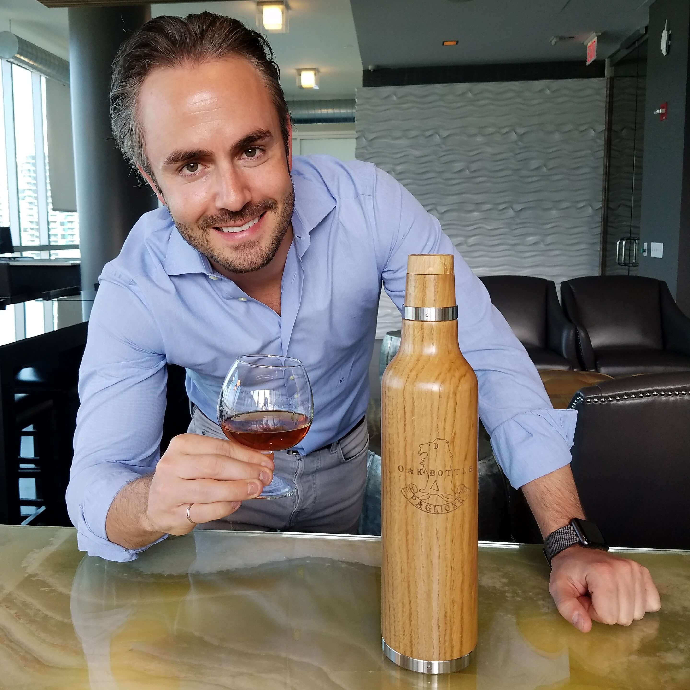 Joe Paglione and his invention, the oak bottle