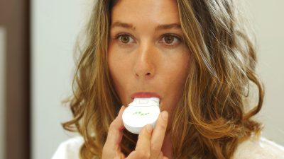 woman using the Mint breathalyzer