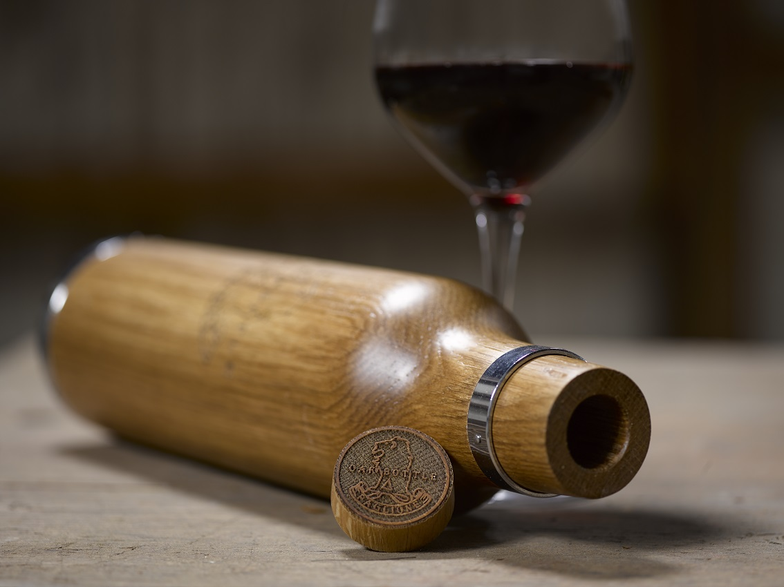the Oak Bottle with a glass of red wine