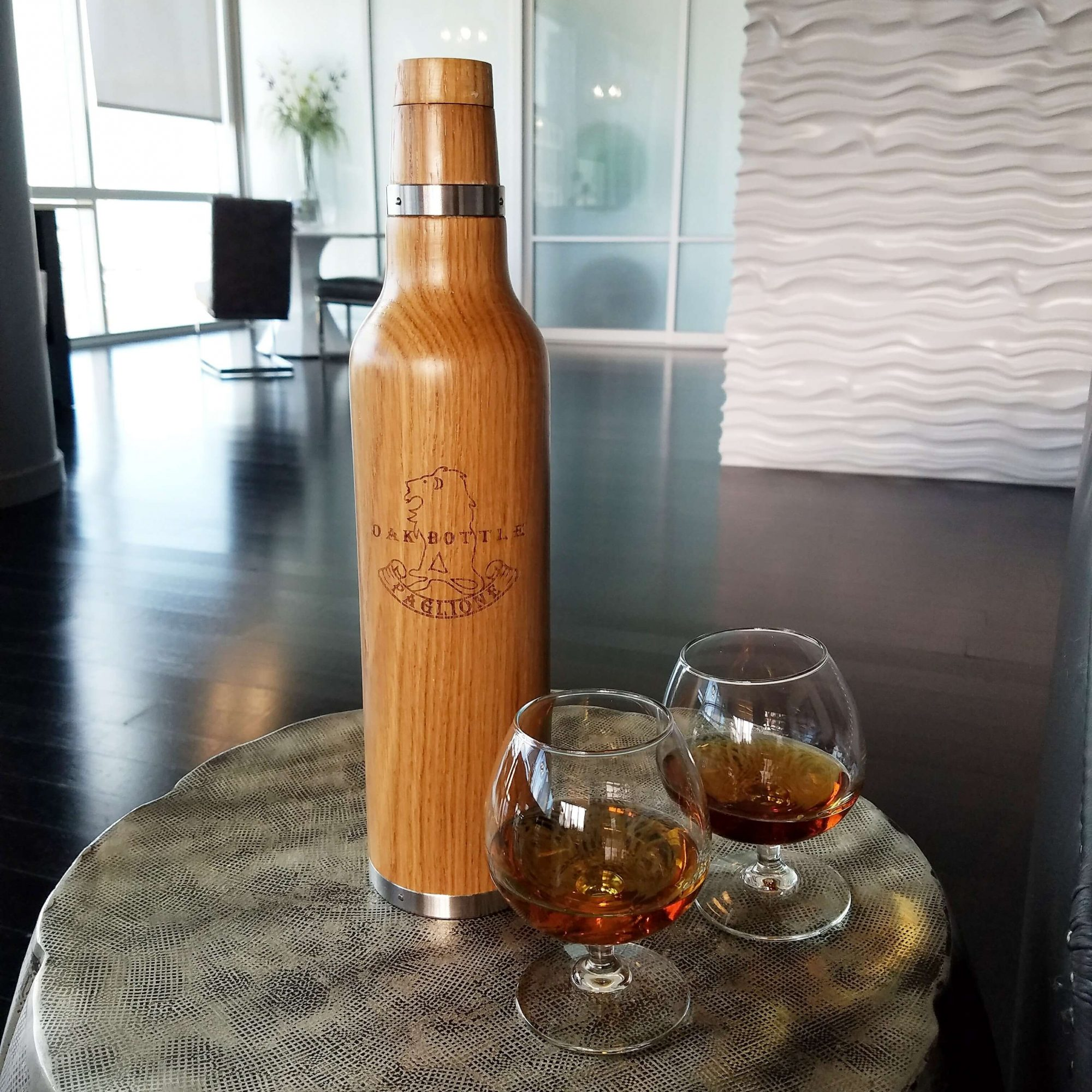 the Oak Bottle with glasses of aged whiskey