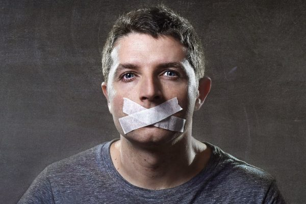 video game voice actors on strike represented by man with tape on his mouth