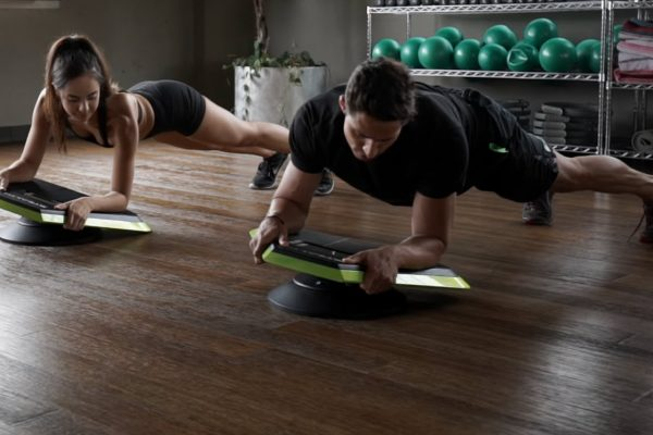 people using the Stealth ab exercise board and app